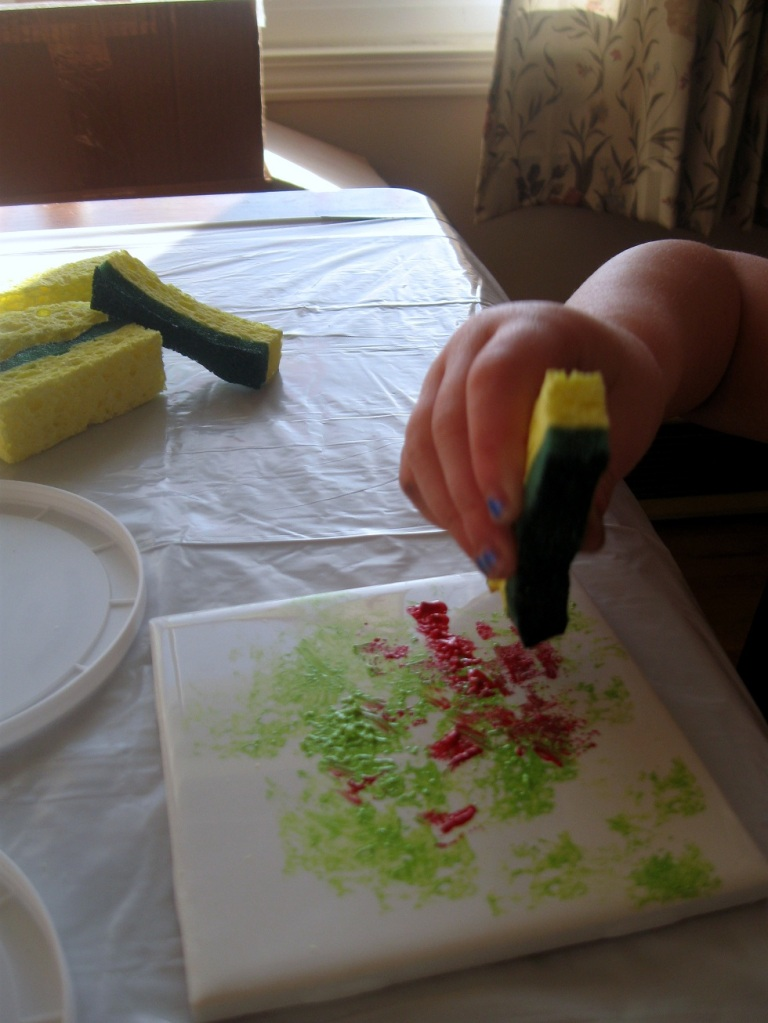 Paint, paint, paint! a three year old tests the limits of acrylic paint and ceramics.