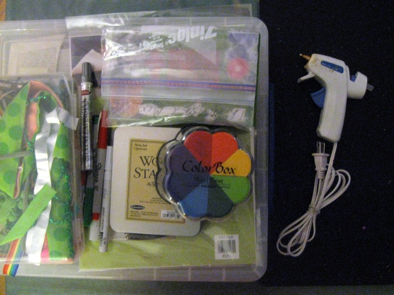 I love gathering supplies. Hot glue, paper, ink pads, fabric...it all jsut comes together so nicely.