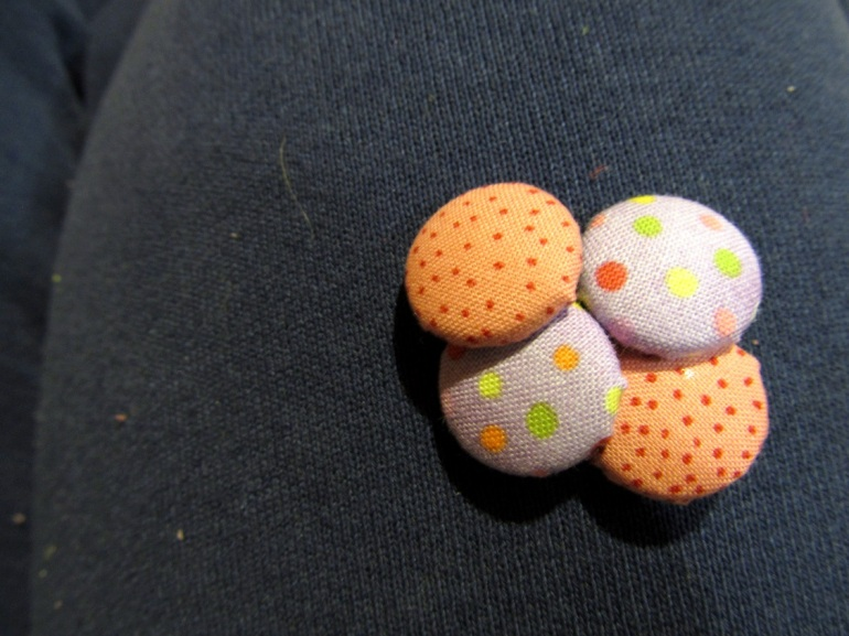 Tiny little fabric buttons. Great use of pretty, pretty prints.
