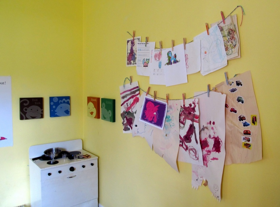 I got a lot of little projects done after work today. Mostly clutter purging, mail shredding boring stuff. But the kiddo and I did hang up two long and braids of yarn on a mostly empty wall in her room. Now we have a place to corral all her creations besides the fridge. Just this makes me so happy I woke up today.