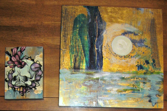 One of my goals for this year was to donate a piece to a local fundraiser art auction. Not only did I meet that goal, my husband and I got three new pieces of original art for our walls. There are two of them, both done on wood panels.