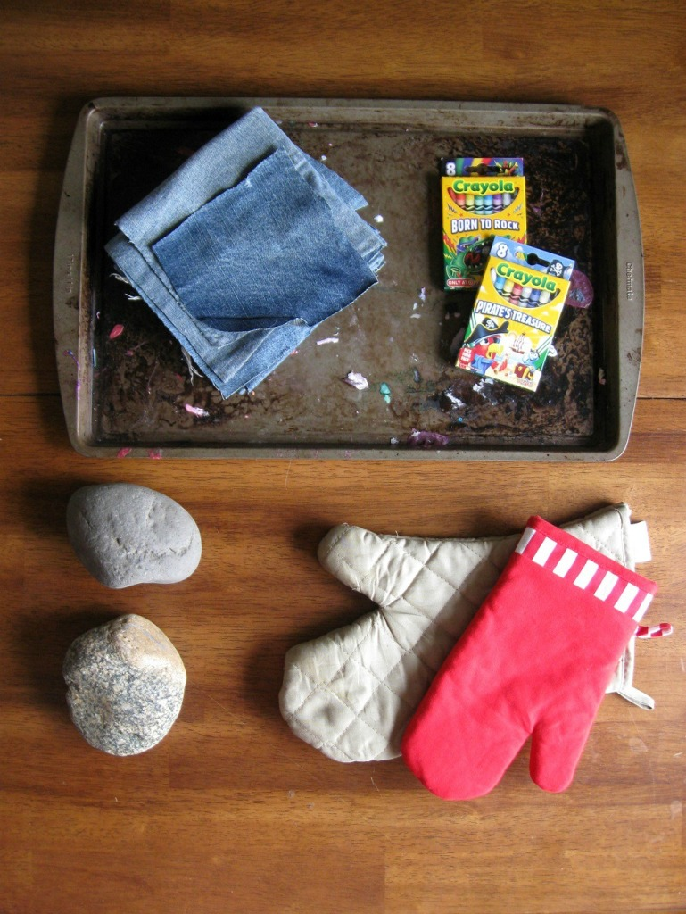 This is a really, really cheap project. I spent $2 on two boxes of crayons at Target. All the rocks were gathered on a walk near our house.