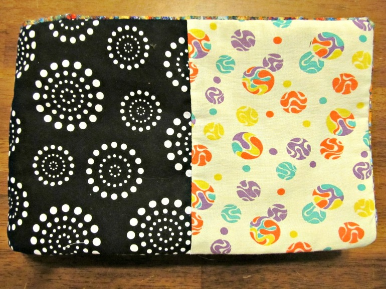 The cover is four pieces of fabric patch worked together. I love both these prints, and they complement each other so well.