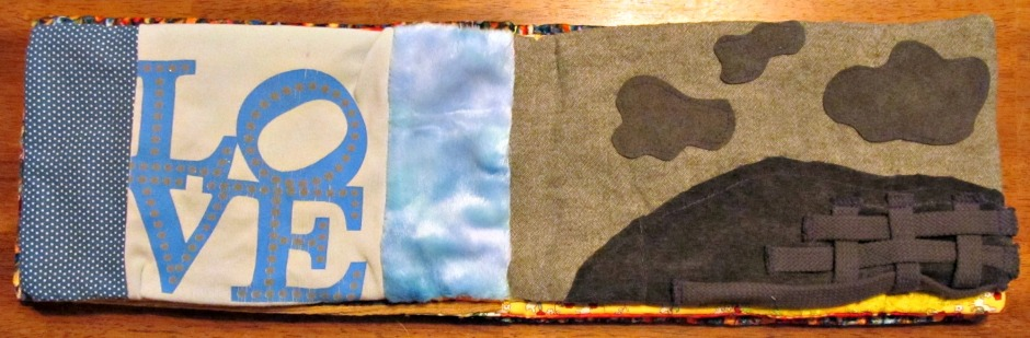 Blue page: Cotton scrap, minky scrap from little man's first Christmas gift and a t-shirt bit.