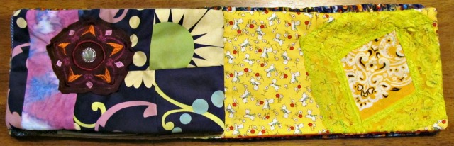 Purple page: Mostly from a purse I loved to literal pieces. Also has a strip of fabric I painted and a medallion from a tank I wore in high school.  Yellow page: Two yellow stash cottons and lace from a shelled cami.